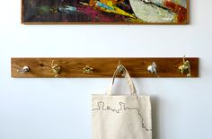 Vintage Trophy Coat Rack:  this would be so cute in a boy's room!