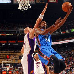 Kevin Durant goes up and over the Suns' Marcin Gortat during the first half.