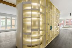 A curved wall of built-in shelves.