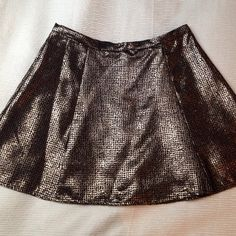 Flirty Black and Gold Metallic Mini Skirt Only worn once for a few hours! Tag says size large, however I wear a pant size 4. When zipped, the waist measures 14.5 inches across. The length is 15.5 inches. ❌Trades ❌PayPal Bundles  Reasonable Offers Skirts Mini