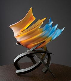 A dramatic sculptural bowl that glows like flickering flames. A great statement piece for your table top. Hemisphere: Tropicale by Brian Russell: Art Glass Sculpture available at www.artfulhome.com