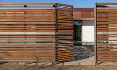 The Loma Linda 2 single-family home mimics its neighbor with the same rusted-metal gates, which keep direct sunlight at bay for those enjoying a day outside on the stylish patio.