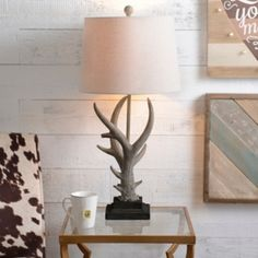 Pefect for a rustic woodland nursery | Natural Antler Table Lamp from Kirklands [affilate link]