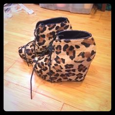 Steve Madden Pony Hair Cheetah Lace-Up Booties Worn 4x, very comfortable, stand out item, always got compliments on these, 6 inch wedge heel, 2 inch platform. Genuine leather and ponyhair #cheetah #stevemadden #ponyhair #leather #wedge #supercute #ladygaga #fivestars #authentic #edgy #realhair #platform #standout #booties #sexy Steve Madden Shoes Platforms