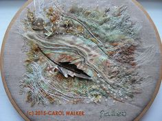 "Carol Walker, Fallen-full view- 2/2015, 8"" hoop, batik, organza, beads threads and fold form metal leaf (by Lee Ann Walker)."