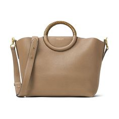skorpios leather market bag by Michael Kors. Tightly plaited ring handles top a structured market bag crafted from pebbled leather. An optional, adjustable should...
