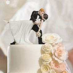 Wedding Cake Topper Idea - The Romantic Dip bride and groom cake topper shows the couple wrapped in a romantic embrace of dance. The bride's pretty pony tail, simple dress and rhinestone shoes give this cake topper a lovely modernized twist on a classic pose. This cake top can be purchased at https://myweddingreceptionideas.com/romantic_dip_dancing_bride_groom_cake_toppers.asp