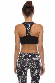 Cute and trendy medium Impact Sports Bra, makes keeping fit fun! Color: Black/White