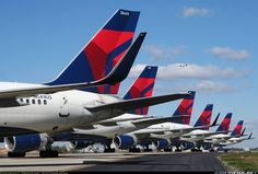 While Hurricane Sandy was slamming the Northeast United States, Delta was cancelling many flights to that region and had to park several Boeing 757s on taxiway SJ at Hartsfield-Jackson Atlanta International Airport. This photo was taken back in October 2012. #JvW