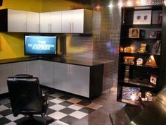 A+serious+video+gamer+felt+compelled+to+create+a+space+where+he+could+indulge+his+hobby+in+style.+The+result+was+this+garage+conversion+complete+with+checkerboard+tile+floors,+plenty+of+storage+space+for+games+and+equipment,+and+a+captain's+chair+for+comfort+and+cool+points.