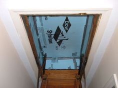Insulating Hideaway Stairs To help with heating and cooling our house, we insulated over our hideaway attic stairs by making a box type frame out of Styrofoam insulation to fit over the stairs opening. Attic Doors, Garage Attic, Attic House, Attic Playroom, Attic Library, Attic Window, Attic Ladder, Attic Loft, Attic Stairs
