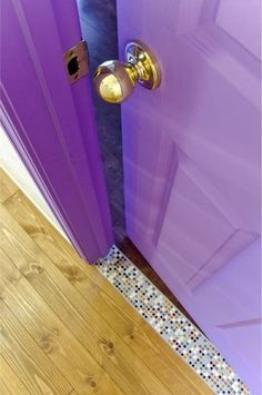 purple door + mosaic tiled doorstep