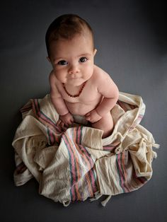 We wrapped Jr. Deniz in our linen cotton towel and we named it Dazzling Deniz No:1 Turkish Towel.