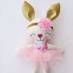 This beautiful handmade bunny doll is made with love! She is about 15 inches tall not including her ears and made from high quality cotton fabrics. Her face is hand embroidered and detailed with cute rosy cheeks and a sparkly nose. Her tutu and headband are removable. Contact me