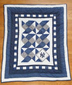 NY Yankees quilt.  Not a yankee fan but can do with any time.  Like the idea