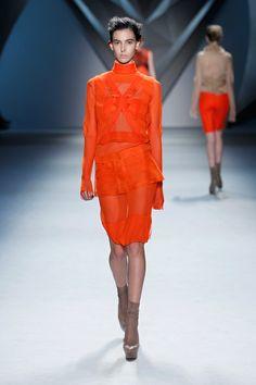 Tangerine silk chiffon crisscross appliqué long sleeve dress with stand melton collar and tangerine silk organza zip-front peplum over tangerine silk chiffon bermuda short.