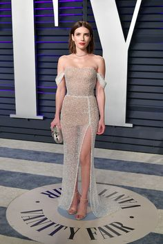 Emma Roberts Sheer Dress - Emma Roberts got majorly sultry in a sheer off-the-shoulder column dress by Yanina Couture at the 2019 Vanity Fair Oscar party. Pretty Dresses, Sexy Dresses, Prom Dresses, Sheer Dress, Strapless Dress Formal, Soirée Des Oscars, Vestidos Oscar, Emma Roberts Style, Belle Silhouette