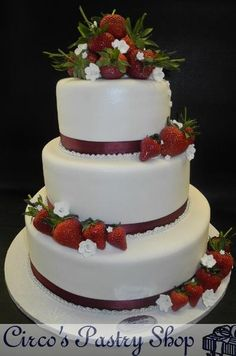 Strawberry & Blossoms Wedding Cake  Fondant White Cake with Fresh Strawberries and Fondant Fruit Blossoms on top, burgundy ribbon to decorat...