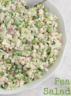 Peas, broccoli, cauliflower, and bacon covered in a creamy dressing in this pea salad recipe!
