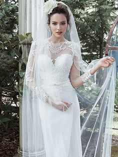 Maggie Sottero - VAUGHN, This demure sheath dress gets an extra dose of drama with full-length illusion sleeves