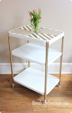 salvaged gold and white painted rolling cart