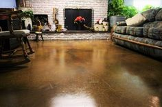 Isn't this gorgeous? Stained concrete can make any concrete floor more luxurious at a minimal investment. CALL (281) 407-0779 for more stain color options and a free quote.