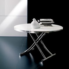 The Globe is a transforming coffee table that opens and expands into a dining table. The Globe features a metal base and hidden wheels for easy movement.