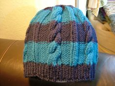 Ravelry: Easy Chunky Cable Hat pattern by Ruth Hilton-Robinson Knitting Patterns Free, Free Pattern, Poncho Patterns, Yarn Store, Chunky Yarn, Caps Hats, Cable Knit, Knitted Hats, Easy