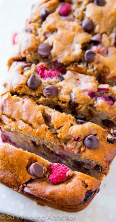 Deliciously moist and incredibly indulgent brown sugar banana bread loaded with dark chocolate chips and raspberries!