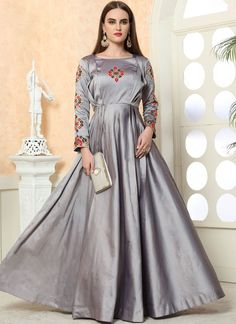 An exceptional grey tafeta silk designer gown will make you appear incredibly stylish and graceful. This pretty attire is showing some brilliant with embroidered work. Buy Gowns Online, Gown Dress Online, Wedding Gowns Online, Designer Wedding Gowns, Designer Gowns, Dresses Online, Indian Designer Sarees, Gowns For Girls, Silk Gown