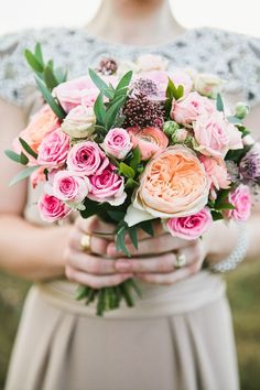 #bouquet full of peachy peony and rose loveliness.   Photography: Britt Spring - www.brittspring.com  Read More: http://www.stylemepretty.com/2014/07/09/animal-themed-country-wedding-in-the-united-kingdom/