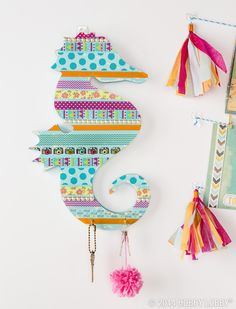 Use washi tape to jazz up your dorm room! Layer your favorite patterns over a fun wooden shape for easy and unique art!
