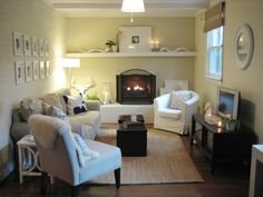 beautiful small family room with white-on-white walls and accent pieces and natural rug.