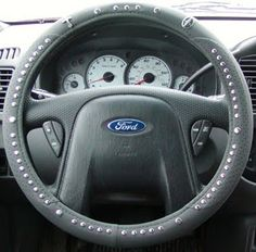 Look closely! Yup, that's a steering wheel rosary. Mind = blown #Catholic #rosary