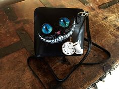 Check out our hand painted leather bags selection for the very best in unique or custom, handmade pieces from our shoulder bags shops. Black Leather Bags, Calf Leather, Cheshire Cat Art, Small Coin Purse, Art Bag, Art Birthday, Custom Bags, Custom Paint, Bag Making