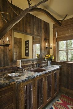 Again, more tree elements that appear a part of the home. Wood cabinetry done right. I LOVE this house.
