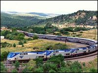 """Amtrak's """"Southwest Chief"""" is at Raton Pass, New Mexico. This is the same scene where the classic photograph of Santa Fe's all-Pullman """"Super Chief"""" was made in 1951."""