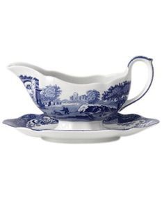 A charming rendering of the Italian countryside. Part of Spode's Blue Italian collection, vivid hues on creamy earthenware radiate old-world charm. | Porcelain | Dishwasher and microwave safe | Web ID