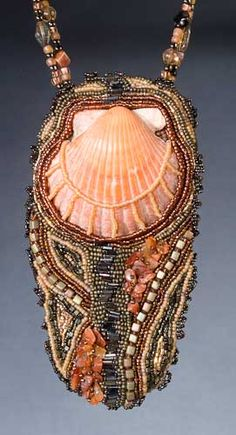 Like the way the seashell is incorporated into the bead embroidery so the focus isn't taken away from the seashell!