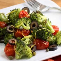 Mediterranean Roasted Broccoli & Tomatoes. Broccoli, grape tomatoes, olive oil, garlic, salt and pepper, lemon zest, lemon juice, black olives, oregano, capers.