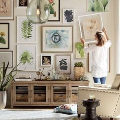 Would you like to learn how to create a beautiful gallery wall that will beautifully complement your home decor? This article covers how you can create the perfect gallery wall. Click through to learn how to hang a gallery wall that will beautifully compl Interior Design Living Room, Living Room Decor, Interior Livingroom, Reclaimed Wood Media Console, Wall Design, House Design, Gallery Wall Layout, Gallery Walls, Eclectic Gallery Wall