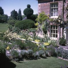 Cecil Beaton house, Reddish. Sotheybys copyright. Gardenista - The lawn ascending from the back door at Reddish House. This was where Beaton spent as much time as he could, the place where he would dig in when working on larger projects. Gardening increasingly preoccupied him, holding as much interest as his excursions to Buckingham Palace or the Vogue studios.