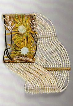 An Art Nouveau 'Two Chrysanthemums' choker, by René Lalique, 1898-1900. Composed of gold, enamel, glass, diamonds and pearls. Source: René Lalique, Exceptional Jewellery 1890-1912.