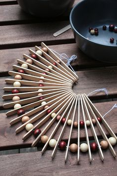 Pot Holder - using popsicle sticks & beads... can be hung on the kitchen wall as art when not in use!
