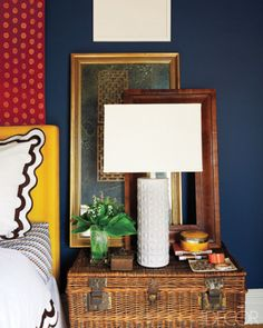 Room/Style: Bedroom, Contemporary   Notes: A lamp by Shades of Light on an antique wicker trunk in decorator Elaine Griffin's Harlem, New York, home.         Photographer: Joshua Mchugh     Designer: Elaine Griffin     Featured in: A Harlem Brownstone's Vivid Transformation     Issue: May 2011
