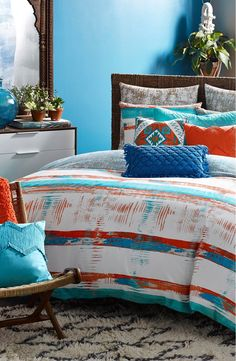 Inspired by the rich texture often found on the buildings of Mexico City, this vibrant bedding set will add a pop of color to any bedroom!
