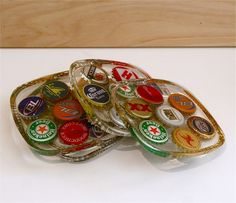 """beer caps! coasters, some smashed flat & attached to a large wooden initial. cool for a """"mancave""""!"""