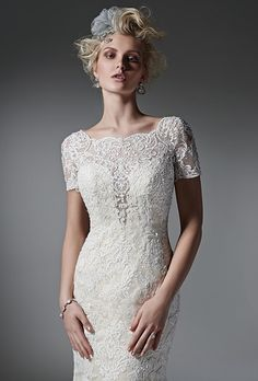 Sottero & Midgley. See more details from Sottero & Midgley��A plunging illusion neckline and delicate, illusion couture length sleeves fit-and-flare wedding dress. Beaded lace appliqu�s and a dramatic, open back. Finished with crystal buttons over zipper closure.