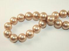 Oryginalne perły austriackiej firmy Swarovski, bez perłowego połysku, wykonane z wysokiej jakości komponentów innowacyjną technologią, dzięki czemu  są odporne na ścieranie, kontakt np. z perfumami na skórze czy promienie UV. Średnica 12mm, średnica otworu ok. 0,7mm #perły #pearls #12mm #swarovski #jewelry