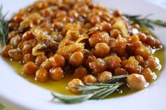 YUMMMER: Greek: Baked Chickpeas (from Kalymnos) 1 lb. chickpeas 3 large onions, thinly sliced cup olive oil 3 sprigs fresh rosemary small dried Pili Pili Peppers (Capsicum Annuum or chili peppers) Salt and freshly ground pepper, to taste